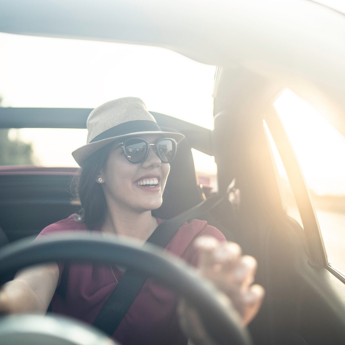 Joyride in a car beautiful lady with hat in the sun